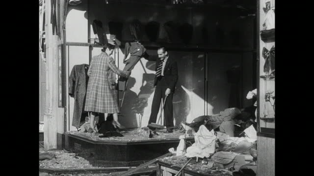MONTAGE Civilians, including the Queen Mother and King George VI salvaging belongings from bombed buildings and walking amidst the rubble / London, England, United Kingdom