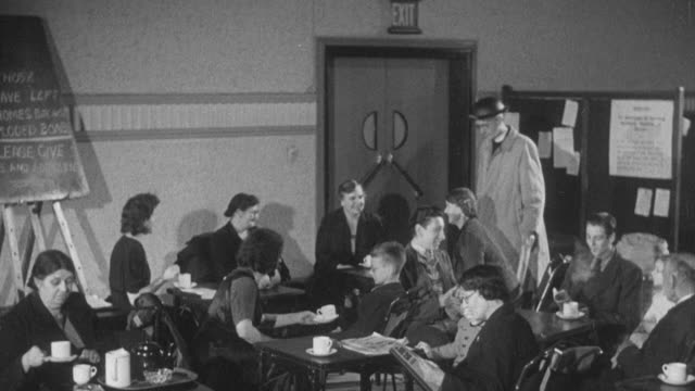 1942 MONTAGE Civilians made homeless by the war receiving shelter and help from the Civil Defense Services / Bristol, England, United Kingdom