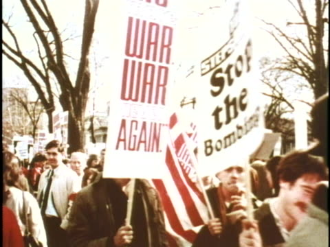 us civilians raise antiwar signs during a demonstration in washington dc - vietnam war stock videos & royalty-free footage