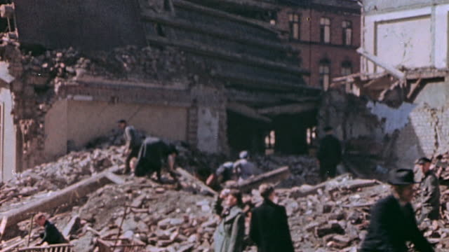 vidéos et rushes de civilians removing the rubble of bombed buildings, and salvaging firewood and building materials / tannenbergsthal, germany - bombardement