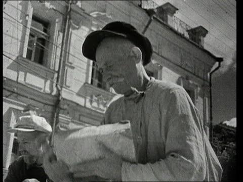 vídeos de stock e filmes b-roll de civilians taking on collective reconstruction work throughout russian and ukranian cities after world war ii destruction/ audio - autocarro elétrico