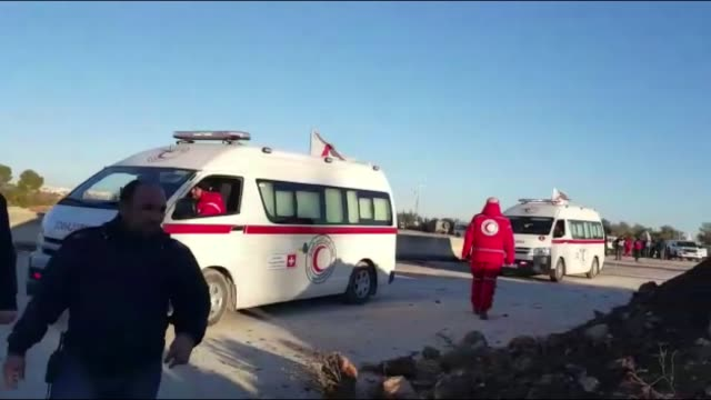 civilians trying to flee from east aleppo that had been under siege by iran led shiite militias and assad regime forces wait to be evacuated in... - belagerung stock-videos und b-roll-filmmaterial
