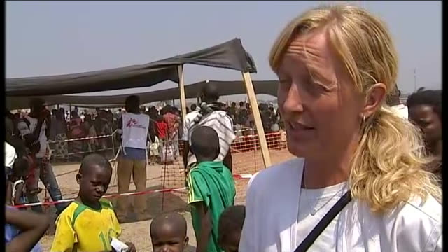 un claims children being deliberately targeted in war lindis hurum interview sot crowds of people walking through camp various of contruction work in... - plank variation stock videos & royalty-free footage