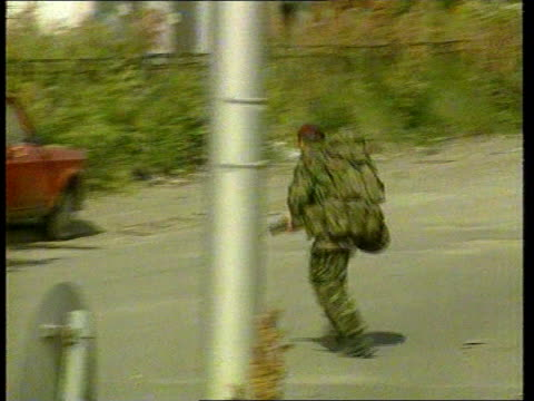 Claims that British troops were hampered KOSOVO British Paratroopers towards down street on patrol LMS Group of Paras on patrol GV Soldier along road...