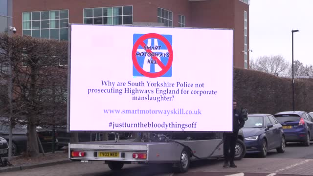 claire mercer, widow of jason mercer, poses with an advertising board outside s. yorks police hq. she is lobbying the force to investigate highways... - corporate business stock videos & royalty-free footage