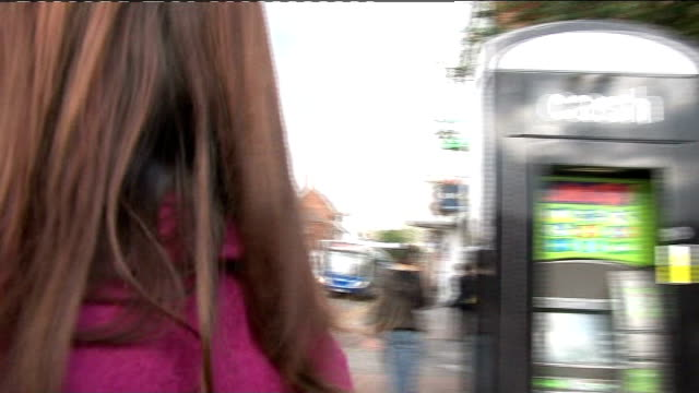 EXT Claire Parker along as reporter attempt to speak to her SOT Parker aggressively pushing camera then away down road
