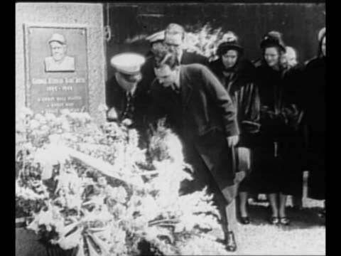 claire ruth pulls cord to unveil plaque honoring her late husband, babe ruth, in a ceremony at yankee stadium / int stadium, with ceremony along... - 飾り板点の映像素材/bロール