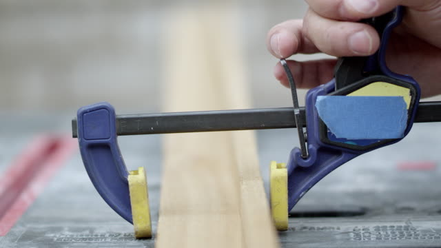 clamp being put on to hold two boards together - clamp stock videos & royalty-free footage