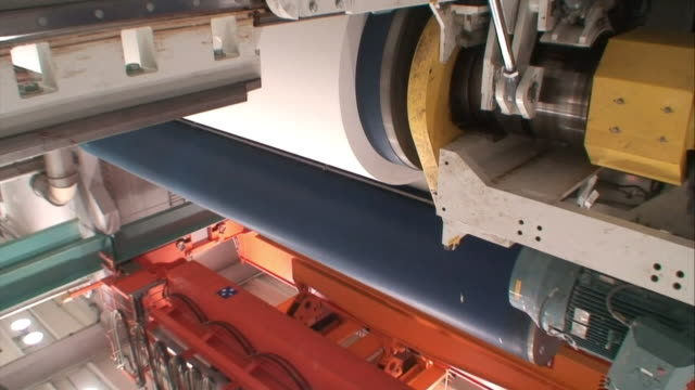 a clamp moves on a machine in a paper mill. - clamp stock videos & royalty-free footage