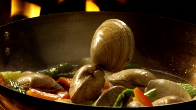 hd clams falling in a pan - chive stock videos & royalty-free footage