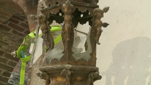 clandon park house fire: restoration work begins; int lamp fixed to wall with mount that looks like a human arm damaged interior of building frieze... - human arm stock videos & royalty-free footage