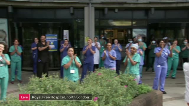 'clap for carers' marks 72nd anniversary of the nhs; england: lancashire: burnley: ext live residents standing outside their homes and clapping,... - ランカシャー点の映像素材/bロール
