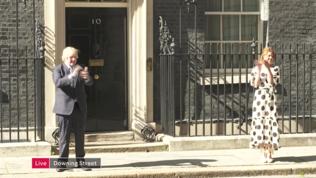 'clap for carers' marks 72nd anniversary of the nhs england london westminster downing street boris johnson mp and annemarie plas clapping outside... - politics stock-videos und b-roll-filmmaterial