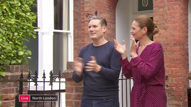 'clap for carers' marks 72nd anniversary of the nhs england north london keir starmer mp and his wife victoria starmer clapping outside their home... - politics stock-videos und b-roll-filmmaterial