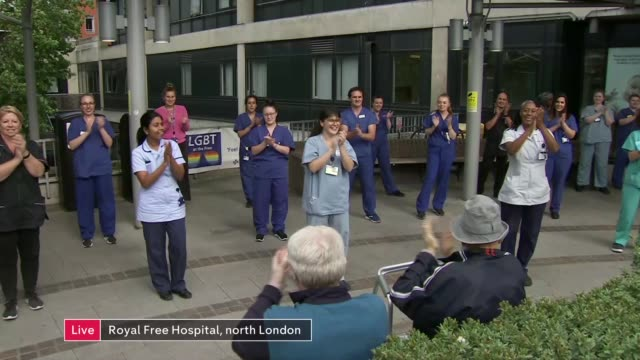 'clap for carers' marks 72nd anniversary of the nhs england north london royal free hospital medics clapping outside hospital taking part in... - politics stock-videos und b-roll-filmmaterial