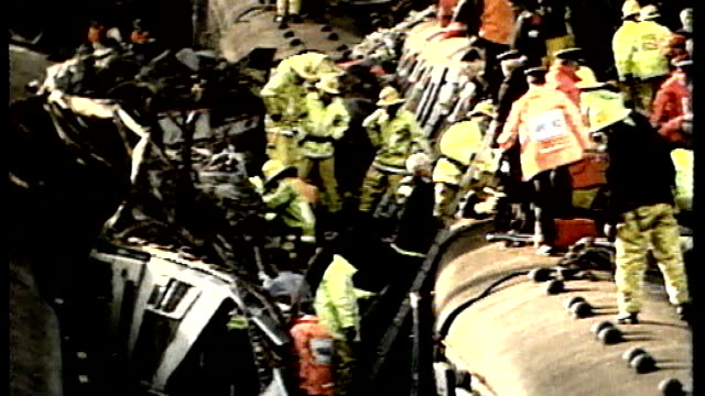 twentieth anniversary / train drivers' new safety fears december 1988 seq police and fire services in train wreckage - train crash stock videos and b-roll footage