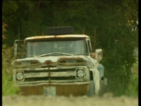 clapped out rusty pickup truck drives along rough country road - imperfection stock videos & royalty-free footage