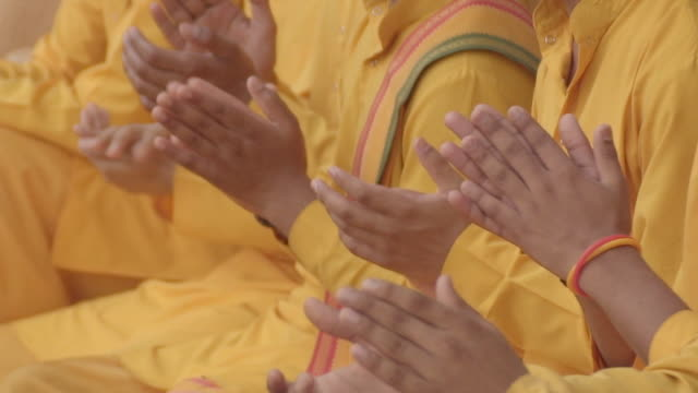 L/S clapping in a Hindu ceremony