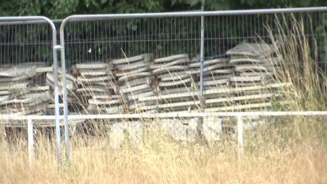 clapton fc to return to the old spotted dog ground ground gvs england london forest gate ext gvs overgrown football pitch gv stand and overgrown... - netting stock videos & royalty-free footage