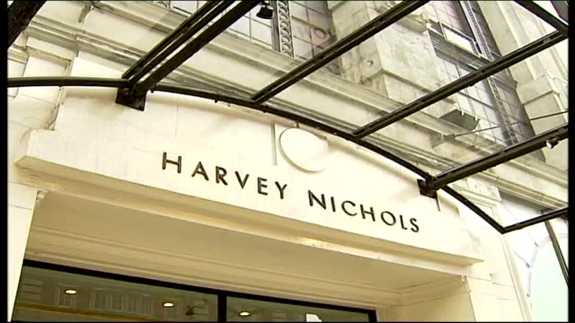 Inquest into police handling of stalker TX Knightsbridge Harvey Nichols sign above entrance to store Police officers in street outside Harvey Nichols