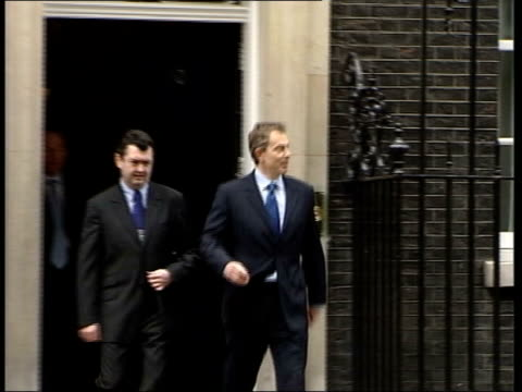 stockvideo's en b-roll-footage met clare short criticises tony blair itn downing street prime minister tony blair mp towards from number 10 as member of press asks him whether he is... - number 9