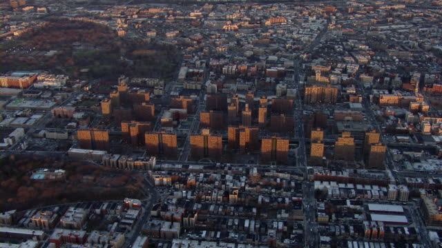 Claremont Village housing projects rise above an urban landscape in the Bronx, New York City.