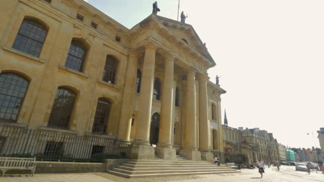 clarendon building,broad street, oxford,pedestrians,pan, - column stock videos & royalty-free footage