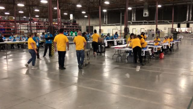 clark county election department workers process polling place equipment and materials at the clark county election department after polls closed on... - clark county nevada stock videos & royalty-free footage