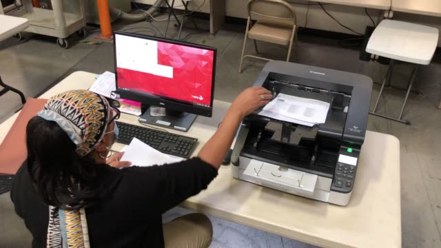 clark county election worker scans mail-in ballots at the clark county election department on november 4, 2020 in north las vegas, nevada. donald... - clark county nevada stock videos & royalty-free footage