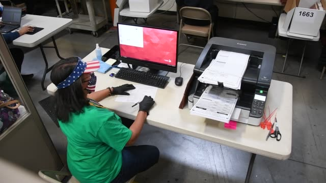 clark county election worker scans mail-in ballots at the clark county election department on november 7, 2020 in north las vegas, nevada. joe biden... - clark county nevada stock videos & royalty-free footage