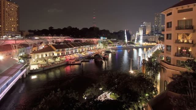 T/L WS HA Clarke Quay on Singapore river at night / Singapore