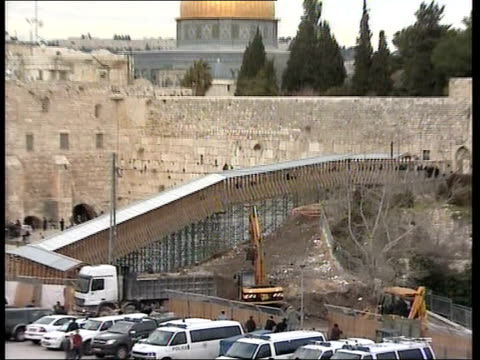 clashes between israeli police and palestinians outside al aqsa mosque:; bulldozers clearing earth during building of new walkway to al aqsa mosque... - temple building video stock e b–roll