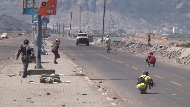 clashes between shiite houthi militants and people's resistance fighters loyal to yemen's president abdrabbu mansour hadi continue in aden southern... - aden stock videos & royalty-free footage