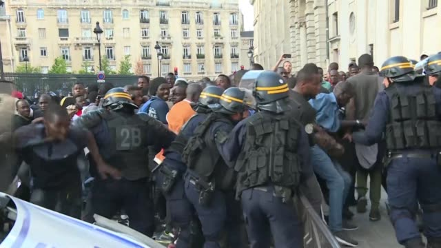 clashes break out between undocumented migrants and the police in front of the pantheon in paris - pantheon paris stock videos & royalty-free footage