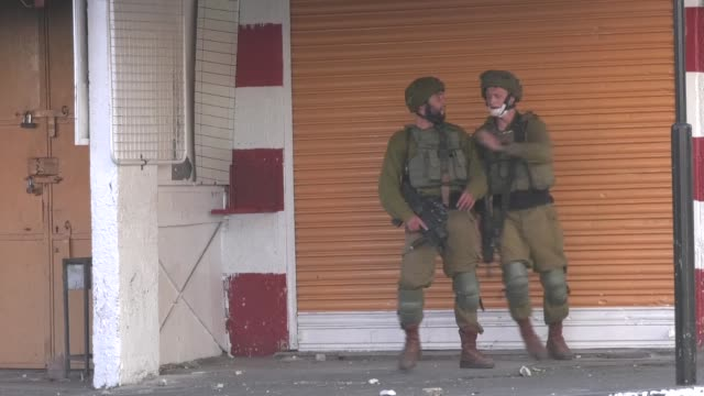 clashes broke out between palestinian youths and the israeli security forces on thursday in the bab alzawiya area in the center of hebron west bank... - israel stock videos & royalty-free footage