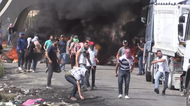 clashes broke out on tuesday between palestinian students and israeli forces in israeloccupied west bank according to local residents israeli... - israel stock videos & royalty-free footage