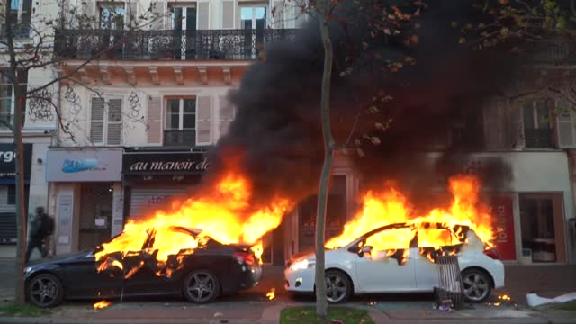 clashes erupt and cars are set on fire in paris as tens of thousands take to the streets to protest against the new security law, with tensions... - law stock videos & royalty-free footage
