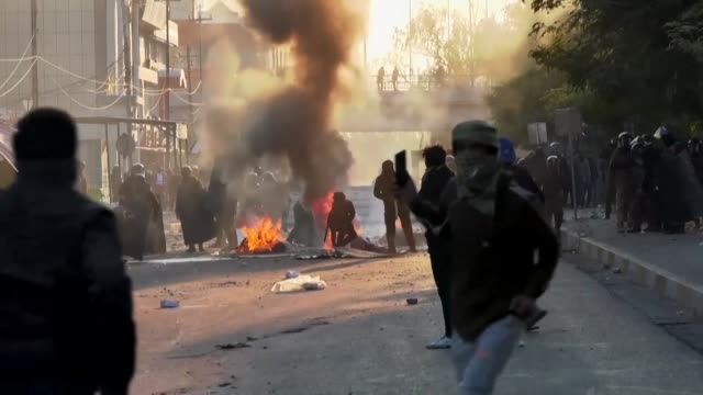 clashes erupt between iraqi security forces and demonstrators during an anti government demonstration in karbala - karbala stock videos & royalty-free footage