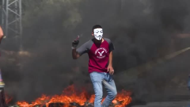clashes erupt between palestinian demonstrators and israeli security forces near the settlement of beit el north of ramallah in the occupied west... - arrest stock videos & royalty-free footage