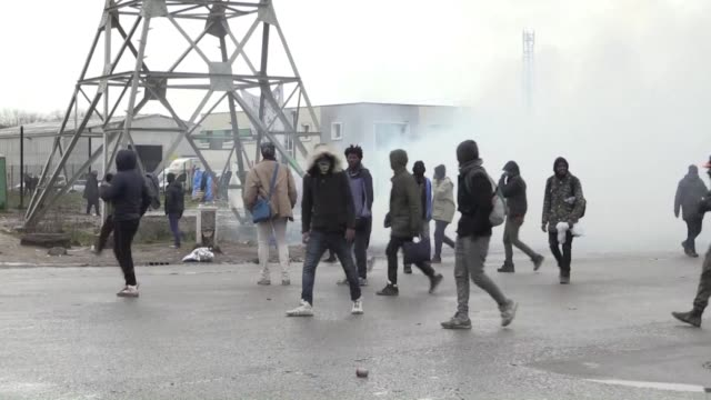 Clashes erupt in Calais near a meal distribution center between rock throwing migrants and police who responded with tear gas