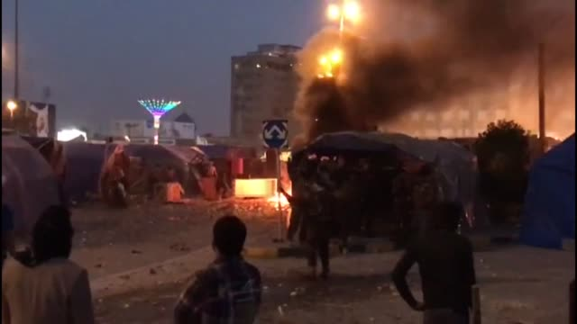 clashes erupt in the holy city of najaf between anti government protesters and supporters of powerful cleric moqtada sadr who raided a protest camp - najaf stock videos & royalty-free footage