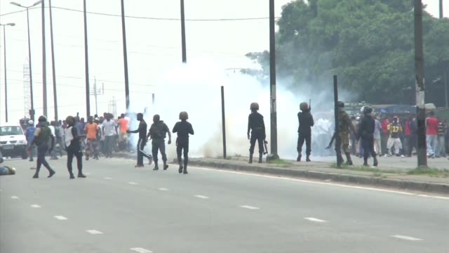 clashes erupted on thursday as troops loyal to one of the fragile west african state's two selfdeclared presidents mobilised to halt a bid by... - côte d'ivoire stock videos & royalty-free footage