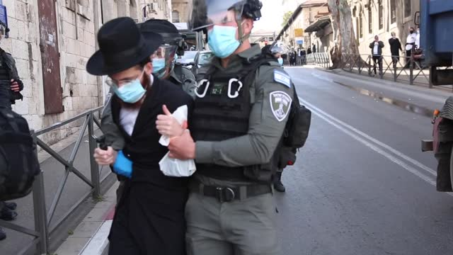 clashes erupted on tuesday, jan. 26, between the israeli police and orthodox jews who gathered against covid-19 restrictions on the streets of... - army stock videos & royalty-free footage