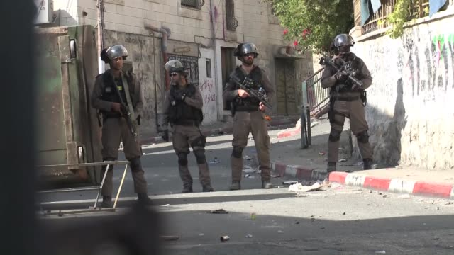 clashes occured between palestinians and israeli security forces during demonstration of palestinians against israeli government's violations over... - israeli military stock videos & royalty-free footage
