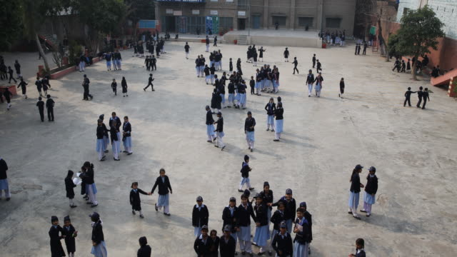 class break and the school yard is full of kids in school uniform. - lahore pakistan stock videos & royalty-free footage