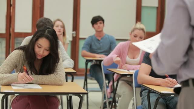 class listening to lecturer - exam video stock e b–roll