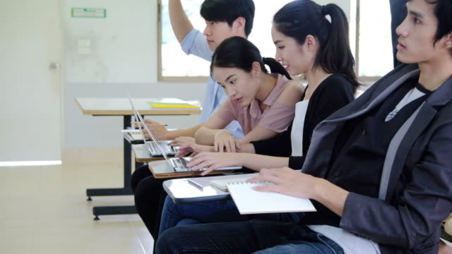 a class on a university listening a teacher,asian students are studying. - student stock videos & royalty-free footage
