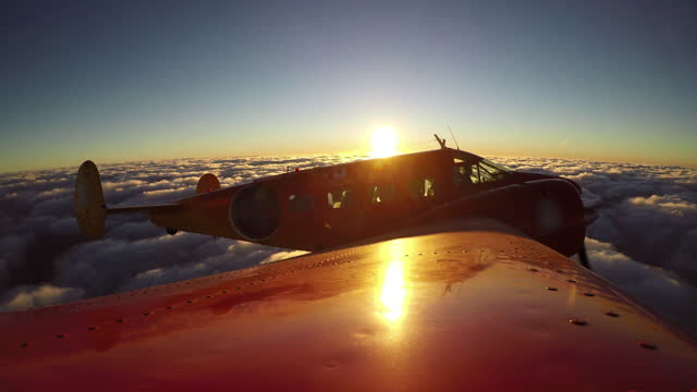classic airplane flying above the clouds at sunset. - 1958 stock videos & royalty-free footage