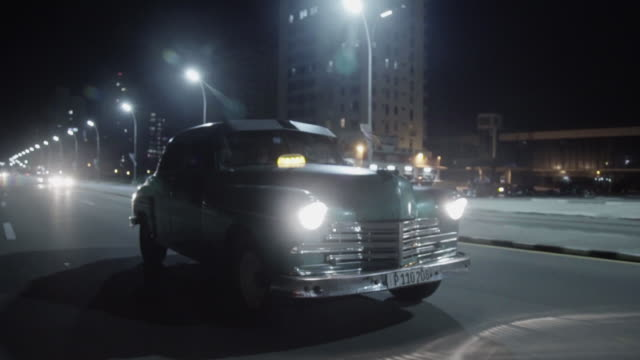 classic american car drives down road in cuba - vintage car stock videos and b-roll footage