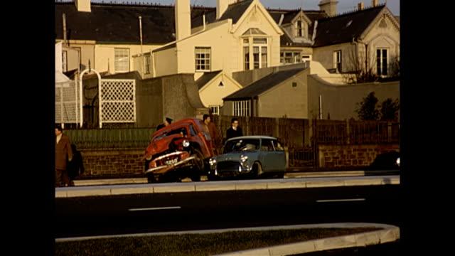 a classic car crash - mini and morris van 1960s - classic car stock videos and b-roll footage